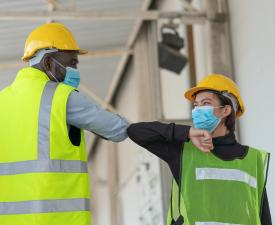 Warehouse workers in facemasks